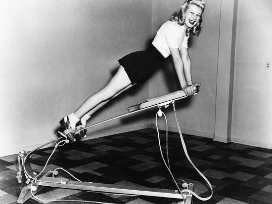 Woman Using Exercise Equipment--Photo