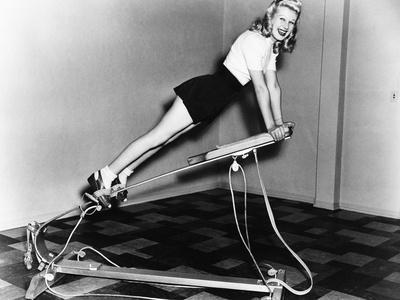 https://imgc.artprintimages.com/img/print/woman-using-exercise-equipment_u-l-q1bwxwr0.jpg?p=0