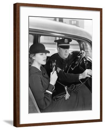 Woman Using Radio in Car with Policeman--Framed Photo