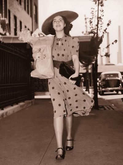 Woman Walking Down Street Carrying Grocery Parcel--Photographic Print