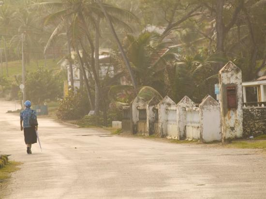 Woman Walking in Sea Mist, Bathsheba, Barbados-Walter Bibikow-Photographic Print