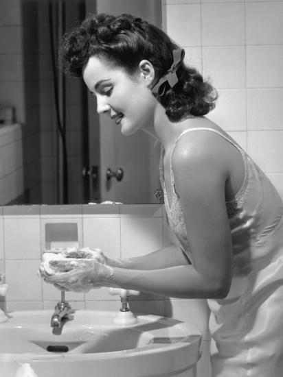 Woman Washing Hands at Bathroom Sink-George Marks-Photographic Print
