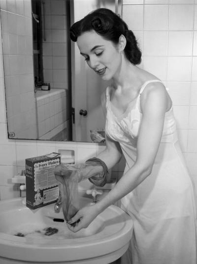 Woman Washing Her Hose at Bathroom Sink-George Marks-Photographic Print