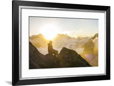 Woman Watches The Sunrise On Top Of A Mountain In North Cascade National Park In Washington-Hannah Dewey-Framed Photographic Print