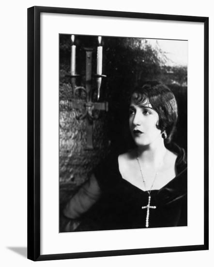 Woman Wearing a Big Cross around Her Neck--Framed Photo
