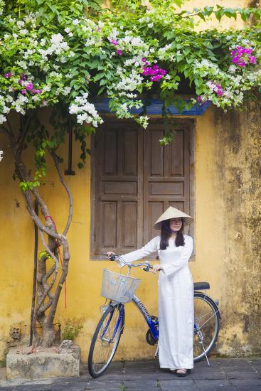 Woman Wearing Ao Dai Dress with Bicycle, Hoi An, Quang Ham, Vietnam-Ian Trower-Photographic Print