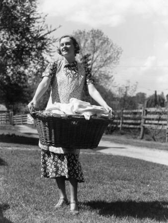 https://imgc.artprintimages.com/img/print/woman-wearing-apron-carrying-a-wicker-basket-of-clean-laundry-outdoors_u-l-q10br5y0.jpg?p=0