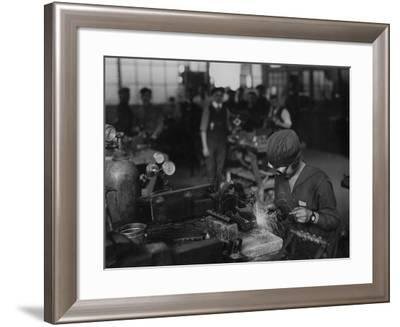 Woman Welding Aircraft Parts--Framed Photographic Print