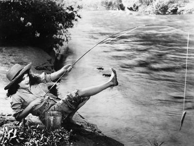 https://imgc.artprintimages.com/img/print/woman-who-caught-a-small-fish-falling-over-backwards_u-l-q1bx02f0.jpg?p=0