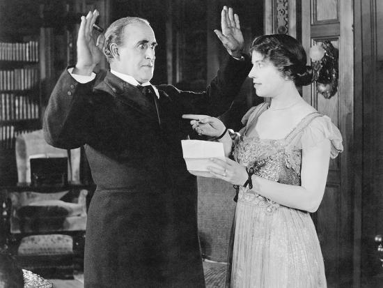 Woman with a Letter in Her Hand Pointing at a Man--Photo