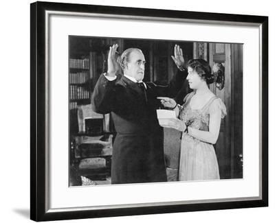 Woman with a Letter in Her Hand Pointing at a Man--Framed Photo