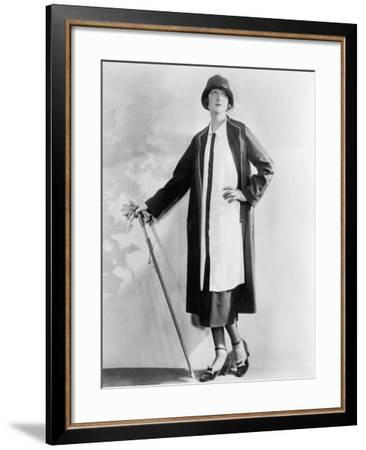 Woman with a Walking Stick in an Elegant Dress and Coat--Framed Photo
