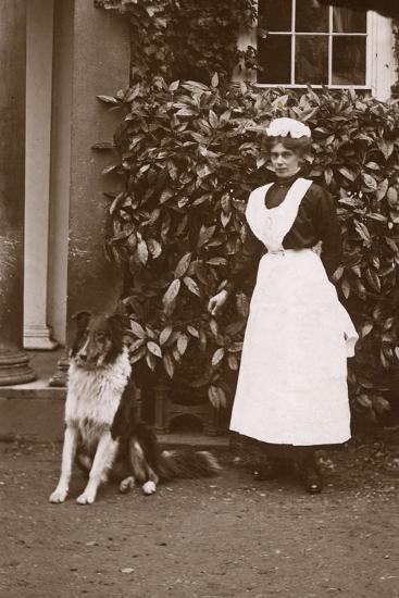 Woman with Collie Dog in a Garden--Photographic Print
