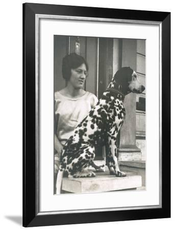 Woman with Dalmatian Outside a House--Framed Photographic Print