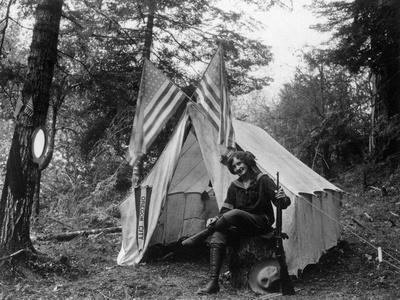 https://imgc.artprintimages.com/img/print/woman-with-gun-sitting-outside-her-tent-fourth-of-july-thompson-creek-or_u-l-q1gnvd20.jpg?p=0