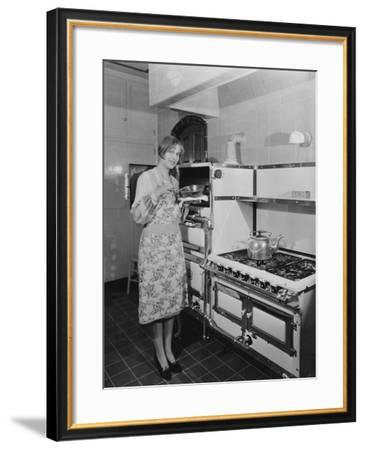 Woman with Large Stove Holding Pan--Framed Photo