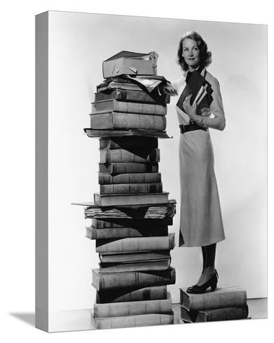 Woman With Pile Of Large Books--Stretched Canvas Print