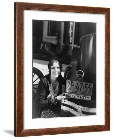 Woman with Prosperity Sign on Car Bumper--Framed Photo