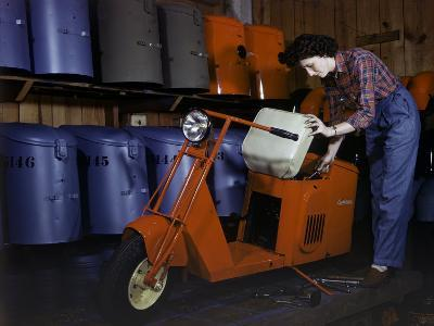 Woman Works on a Cushman Scooter for the War Effort-B^ Anthony Stewart-Photographic Print