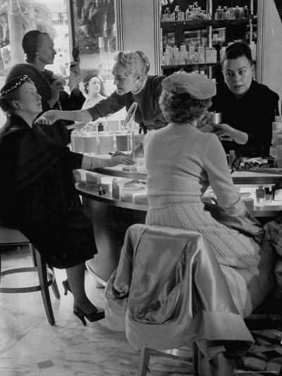 Women at a Powder Bar in Department Store Being Advised on Make Up by Operators-Leonard Mccombe-Photographic Print