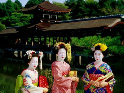 Women Dressed As Geisha with Building in Background, Heian-Jingu, Kyoto, Japan-Frank Carter-Photographic Print