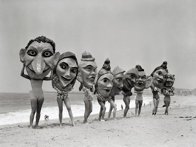 Women Holding Giant Masks-Bettmann-Premium Photographic Print