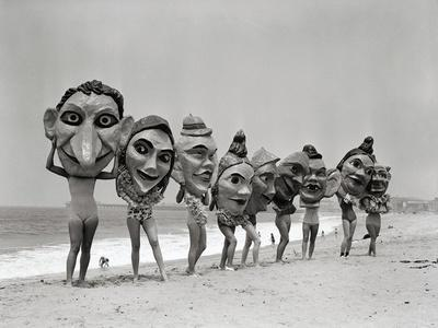 Women Holding Giant Masks-Bettmann-Photographic Print