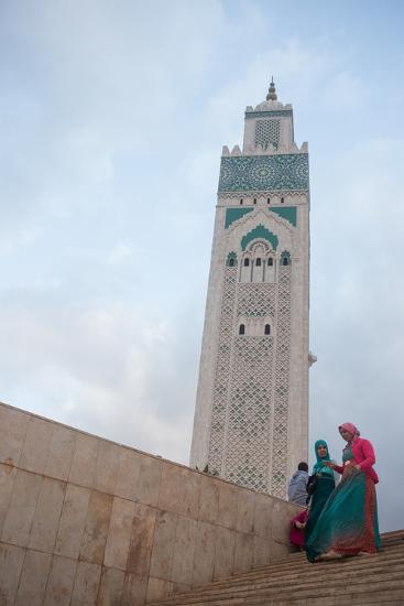 Women in Colorful Djelabas and Head Scarves Walk Down Stairs in Front of Hassan Ii Mosque, Morocco-Erika Skogg-Photographic Print