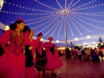 Women in Flamenco Dresses at Feira de Abril, Sevilla, Spain-John & Lisa Merrill-Photographic Print