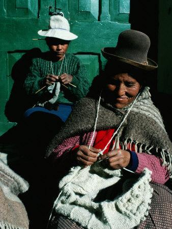 https://imgc.artprintimages.com/img/print/women-in-hats-knitting-outside-in-the-sunshine-by-a-green-wooden-door-peru_u-l-p209ij0.jpg?p=0
