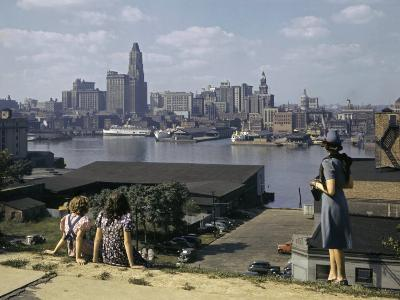 Women Look at Baltimore's Downtown from across the Patapsco River-W^ Robert Moore-Photographic Print