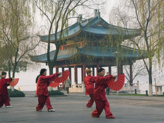 Women Practising Tai Chi in Front of a Pavilion on West Lake, Hangzhou, Zhejiang Province, China-Kober Christian-Photographic Print