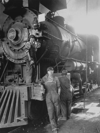 Women Rail Workers Standing at Work on Engine of Train, During WWI at Great Northern Railway--Photographic Print
