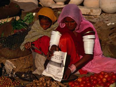 Women Selling Vegetables and Nuts at Jaisalmer Street Market, Jaisalmer, Rajasthan, India-Jane Sweeney-Photographic Print