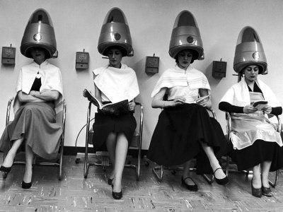 https://imgc.artprintimages.com/img/print/women-sitting-and-reading-under-hairdryers-at-rockefeller-center-pamper-club_u-l-p43uop0.jpg?artPerspective=n
