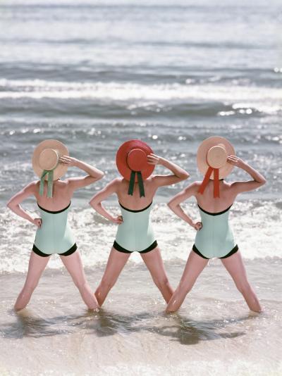 Women Standing on Beach in Ocean-Dennis Hallinan-Photographic Print