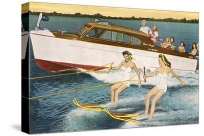 Women Waterskiing by Motorboat