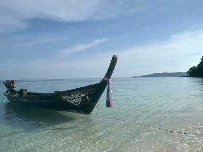 Wooden Boat Named Paradise is Tethered to a Palm Tree-Kate Thompson-Photographic Print