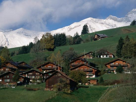 Wooden Chalets on Slope with Snow-Capped Peaks in the Background, Rougemont, Switzerland-Martin Moos-Photographic Print