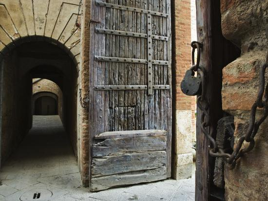Wooden Fortified Gates and Alley of Medieval Town, Buonconvento, Italy-Dennis Flaherty-Photographic Print