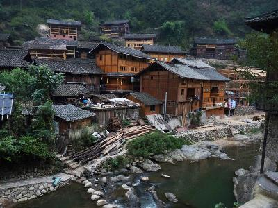 Wooden Houses Line the Duliu River in Xijiang-O^ Louis Mazzatenta-Photographic Print