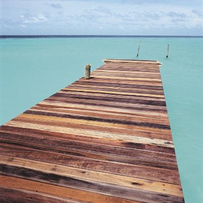 Wooden jetty leading out to sea--Photographic Print