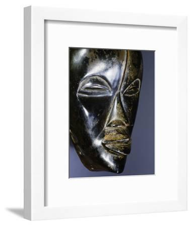 Wooden mask of a type called a Deangle, Dan-Ngere tribal complex, West Africa-Werner Forman-Framed Photographic Print