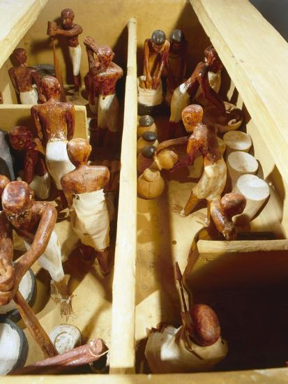 Wooden model a bakery. Workers grind grain to flour-Werner Forman-Giclee Print