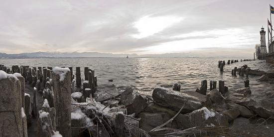 Wooden Poles Covered with Ice, Island Lindau in Lake Constance, Swedish Flag, Lighthouse, Lindau-Markus Leser-Photographic Print