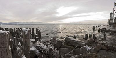 https://imgc.artprintimages.com/img/print/wooden-poles-covered-with-ice-island-lindau-in-lake-constance-swedish-flag-lighthouse-lindau_u-l-q11zbif0.jpg?p=0