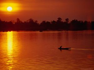 Fisherman Heading Out for Night Fishing Under Mekong River Sunset, Si Phan Don, Laos by Woods Wheatcroft