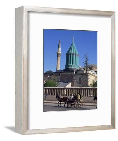 Horse and Cart Passes the Mevlana Tekke Museum, Konya, Anatolia, Turkey