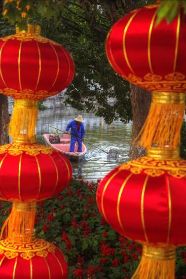 Worker in Boat Cleaning Green Lake, Kunming China-Darrell Gulin-Photographic Print