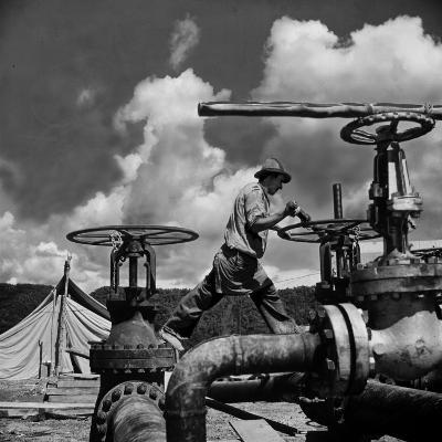 Worker Opening up a Pipeline to Let the Oil Flow-Thomas D^ Mcavoy-Photographic Print